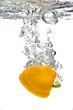 yellow pepper are dropped into water