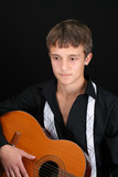Teenage male in casual attire playing guitar poster