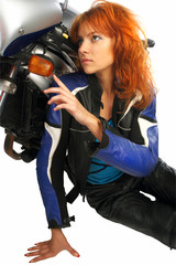 Sexy girl with motorcycle equipment
