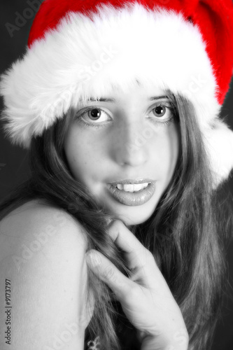 poster of Brunette Teenager wearing a fluffy christmas hat
