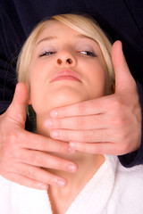 blond woman face massage and hands of therapist
