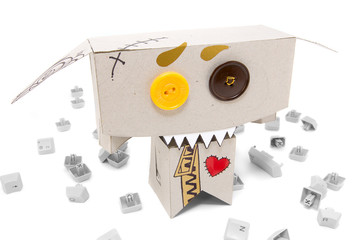 Toothy cardboard toy and broken keyboard buttons around