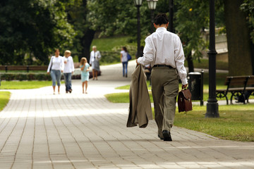 Businessman walking on a park