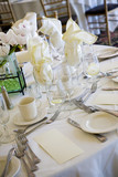 table set up for fine dining during a catered wedding event poster