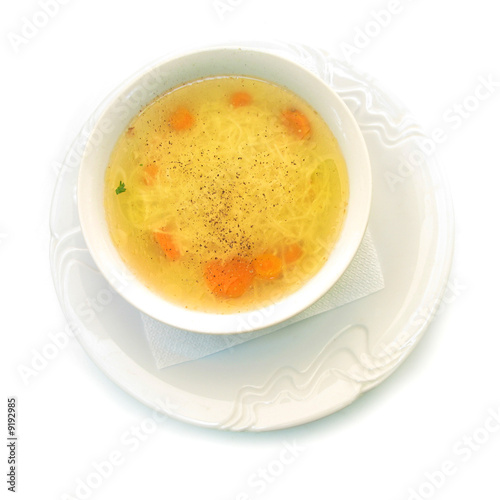 Chicken soup in white bowl