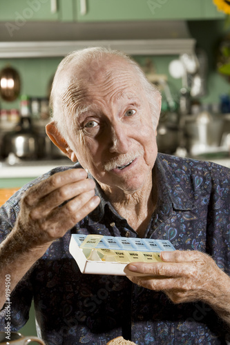 Portrait of Elder Man Taking Medications