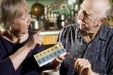 Portrait of Senior Couple Discussing Medications poster