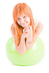 Young smiling girl plays with a ball for fitness