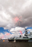 Fireworks at the cloudy sky over navy parade on Neva river poster