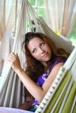 beautyful long-haired girl relaxing in hammock poster