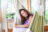 beautyful long-haired girl relaxing in hammock poster