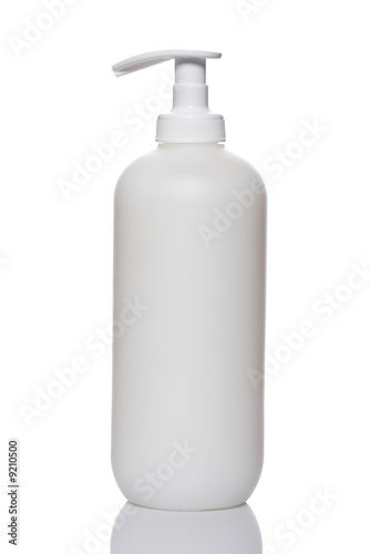 Plastic pump soap bottle reflected on white background