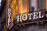 Fototapety Illuminated Parisian hotel sign taken at dusk