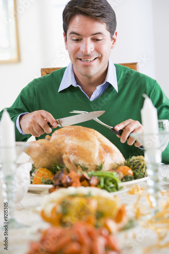 Man Excitedly Carving A Turkey