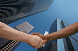 Two Men of Different Ethnicities Shaking Hands in Agreement poster