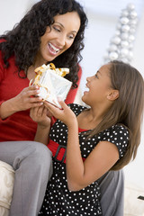 Mother Giving Daughter Her Christmas Present