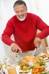 Man Carving Roast Chicken