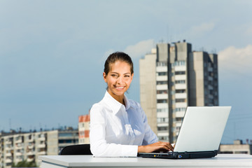 Successful business lady working with laptop