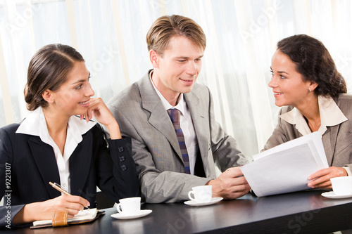 Portrait of business team interacting with each other