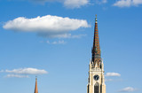 Towers of a Christian Catholic Church on a blue cloudy sky poster