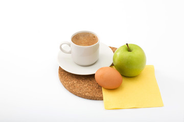 light morning meal: coffee, green apple and hard-boiled egg