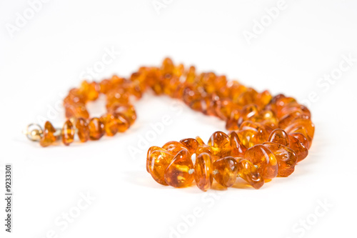Amber necklace on white background