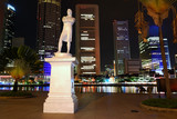 Raffles statue on Clark Quay in Singapore in the night poster