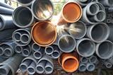 Grey and orange plastic pipes