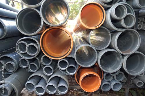 Grey and orange plastic pipes - 9233562