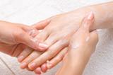 applying peeling scrub or moisturizing cream onto the hands poster