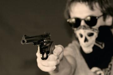 masked man with hand gun