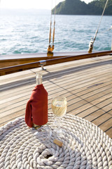 A bottle of wine on a yacht's wooden deck