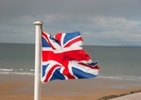Flag of United Kingdom on the shore poster