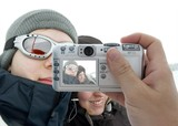 Taking pictures of winter vacation with digital camera poster