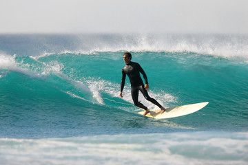 Longboarder executing a bottom turn