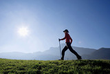 Woman exercising Nordic Walking, Austria, alps