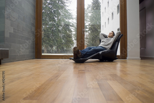 Man relaxing in armchair