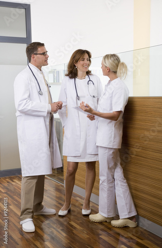 Doctors talking with nurse