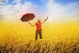 happiness and freedom - woman with red umbrella on field poster