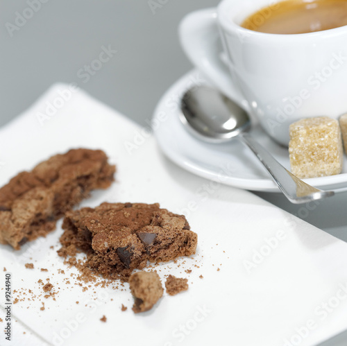 A cup of Espresso and chocolate cookies, detail