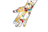 Hand filled with pills, close-up