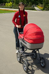 Young woman with red baby carriage