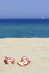 flips flops on an empty sandy beach, Corsica, France