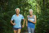 Senior couple jogging, portrait