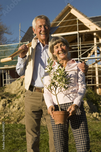 Senior couple gardening, smiling, portrait, low angle view