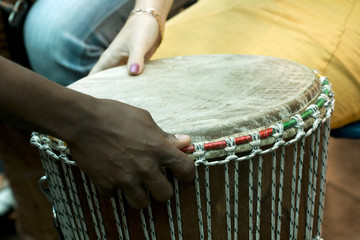 Playing on the african drum, celebration
