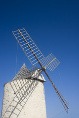 an old windmill on a sunny day