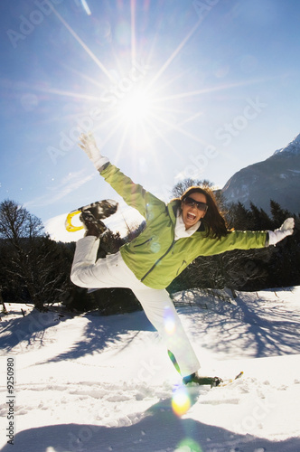 Woman with snowshoes, jumping