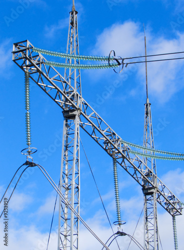 High voltage cable line at blue sky background