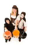 Adorable trick or treaters in halloween costumes poster
